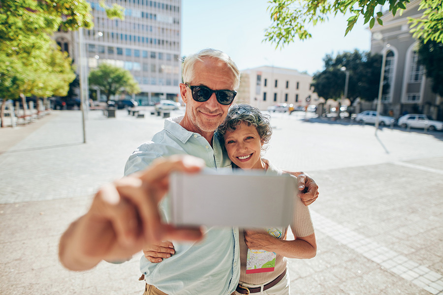 Senior couple takes a picture of themselves with cell phone